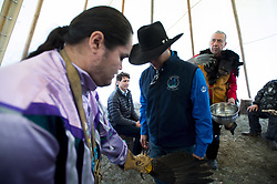 Prime Minister Justin Trudeau looks on as a chief receives a water cleansing by spiritual leader Cecil Grinder along with Chiefs of the Tsilhqot'in National Government near Chilko Lake, B.C., Friday, Nov. 2, 2018. The Prime Minister was in the area to apologize to the Tsilhqot'in community for the hangings of six chiefs during the so-called Chilcotin War over 150 years ago. Photo by The Canadian Press /Jonathan Hayward/ABACAPRESS.COM