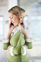 Business woman using mobile phone in office