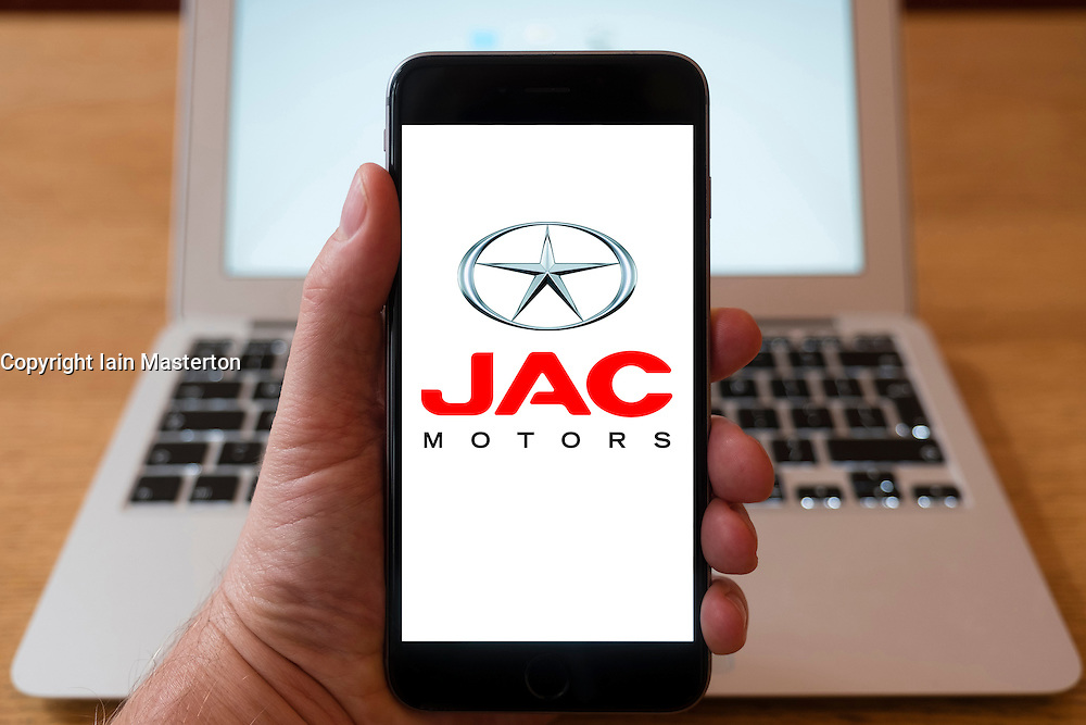 Using iPhone smartphone to display logo of JAC Motors a Chinese car manufacturer