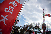 A left wing demonstration against the exploitation of farmers during the construction of Narita Airport. Shiba Park, Tokyo, Japan. Sunday March 23rd 2014. The main organiser of the protest was The Farmers' league Against Narita Airport. Around 1,000 activists from this league and other unions took part.