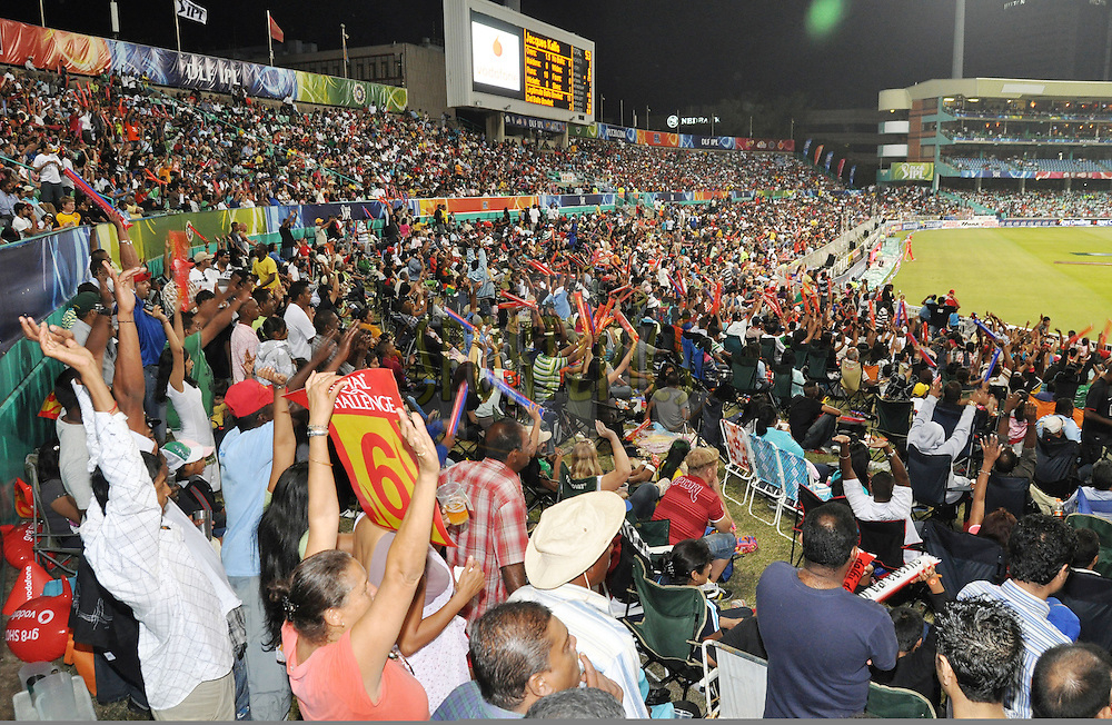 DURBAN, SOUTH AFRICA - 24 April 2009. Spectators cheer as a six is hit during the IPL Season 2 match between the Royal Challengers Bangalore and the Kings X1 Punjab held at Sahara Stadium Kingsmead, Durban, South Africa..
