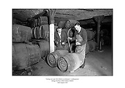 Testing ten-year-old whiskey at Jameson's underground storage facility at Bow Street, Dublin.<br />