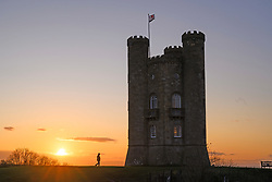 © Licensed to London News Pictures. 07/11/2019. Broadway, Worcestershire, UK. The sun sets over the Cotswolds behind Broadway Tower on a cold autumnal evening in Worcestershire. Photo credit: LNP