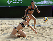 STARE JABLONKI POLAND - July 2:  Katrin Holtwick /1/ and Ilka Semmler of Germany in action during Day 2 of the FIVB Beach Volleyball World Championships on July 2, 2013 in Stare Jablonki Poland.  (Photo by Piotr Hawalej)