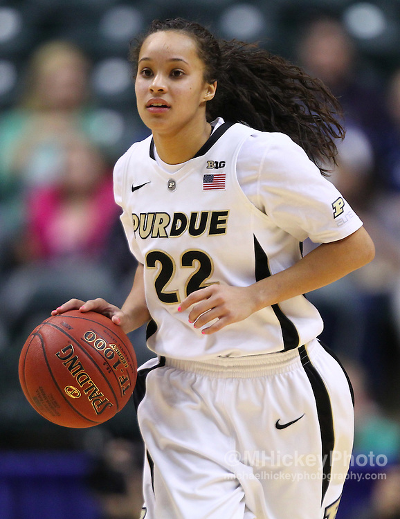 March 04, 2012; Indianapolis, IN, USA; Purdue Boilermakers guard KK Houser (22) brings the ball up court  against the Nebraska Cornhuskers during the finals of the 2012 Big Ten Tournament at Bankers Life Fieldhouse. Purdue defeated Nebraska 74-70 in 2OT. Mandatory credit: Michael Hickey-US PRESSWIRE