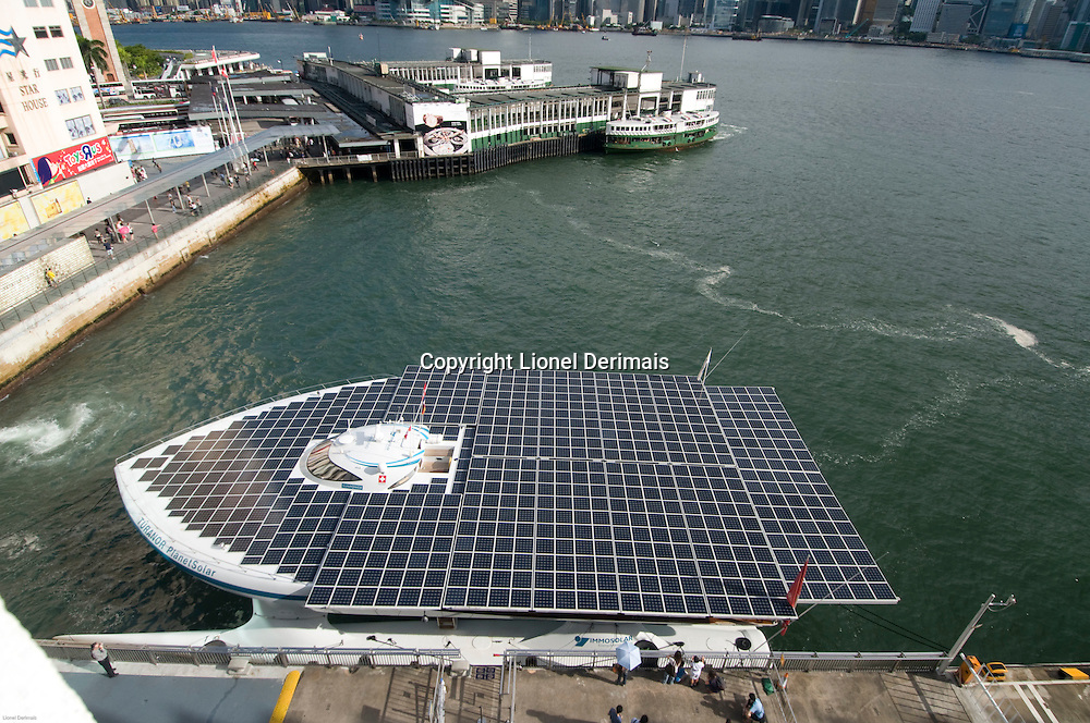The solar powered ship Turanor at the Ocean Terminal dock in Hong Kong Victoria harbour. The Turanor is used in the 1st solar boat expedition around the world. August 18th 2011.