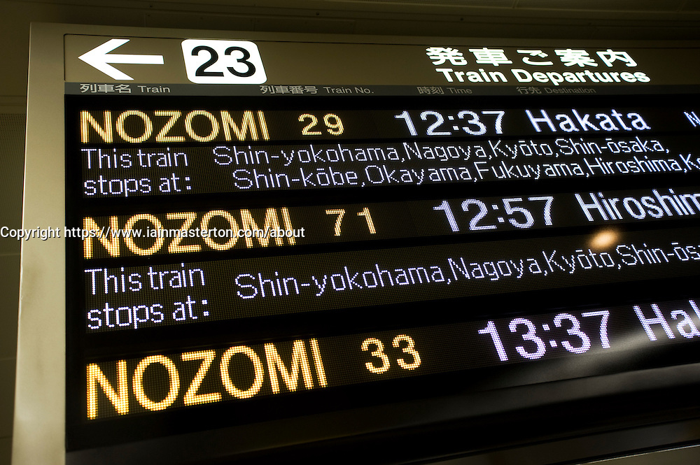 Detail of information board showing bullet train departures at Tokyo Station in Japan