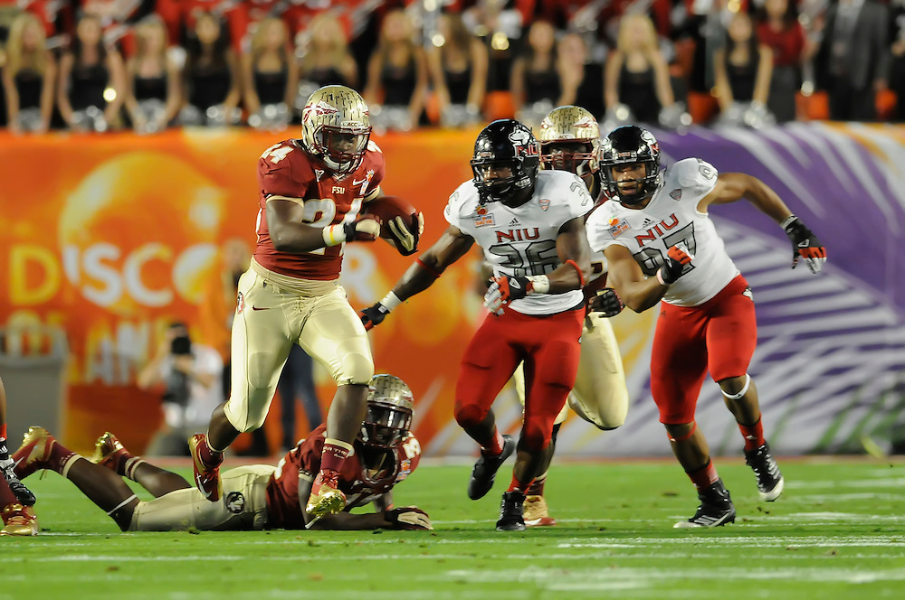 January 1, 2013: Lonnie Pryor #24 of Florida State rushes for a touchdown during the NCAA football game between the Northern Illinois Huskies and the Florida State Seminoles at the 2013 Orange Bowl in Miami Gardens, Florida. The Seminoles defeated the Huskies 31-10.