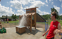 "Tony Delgado watches as an incoming water balloon makes a direct hit on its target Thursday afternoon at Gunstock Mountain Resort's new ""Water Wars"" adventure.  (Karen Bobotas/for the Laconia Daily Sun)"