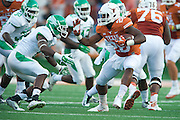 AUSTIN, TX - AUGUST 30:  Malcolm Brown #28 of the Texas Longhorns breaks free against the North Texas Mean Green on August 30, 2014 at Darrell K Royal-Texas Memorial Stadium in Austin, Texas.  (Photo by Cooper Neill/Getty Images) *** Local Caption *** Malcolm Brown