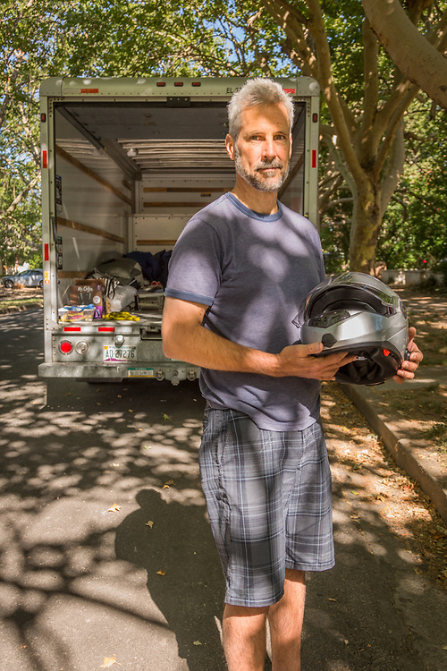 """I just sold my house and everything I own.  At the end of the month, I will ride my motorcycle to Seattle, buy a sailboat and circle the world.  I also need to find a woman who likes boats.""  -Steven Bode, age 55, contemplates the next phase of his life in front of his father's home in Calistoga."