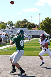 08 September 2012:  Taylor Dee looks over his shoulder for a pass that turn into a touchdown during an NCAA division 3 football game between the Alma Scots and the Illinois Wesleyan Titans which the Titans won 53 - 7 in Tucci Stadium on Wilder Field, Bloomington IL