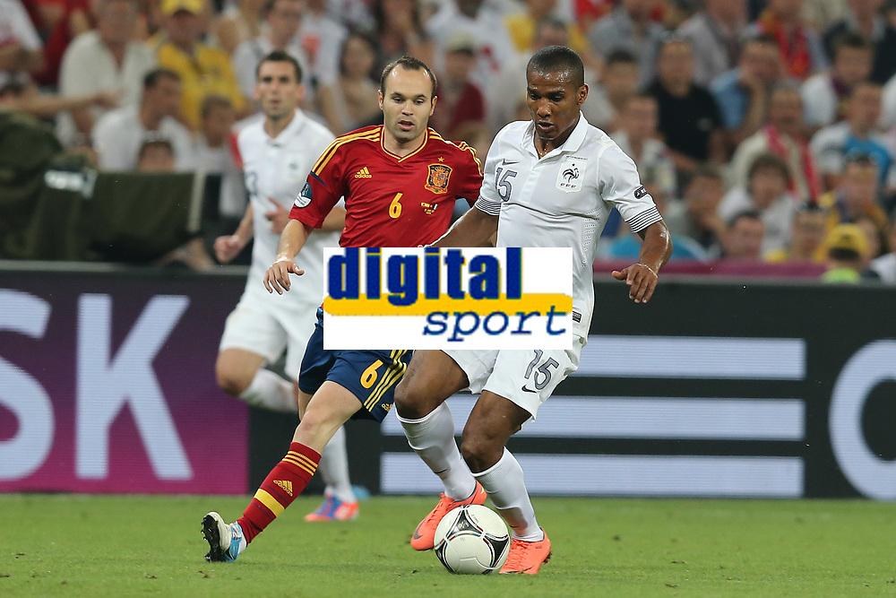 FOOTBALL - UEFA EURO 2012 - DONETSK - UKRAINE  - 1/4 FINAL - SPAIN v FRANCE - 23/06/2012 - PHOTO PHILIPPE LAURENSON /  DPPI - ANDRES INIESTA (ESP) / FLORENT MALOUDA (FRA)