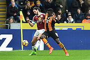 Burnley FC midfielder George Boyd (21) and Hull City player Alfred N'Diaye (10)  during the Premier League match between Hull City and Burnley at the KCOM Stadium, Kingston upon Hull, England on 25 February 2017. Photo by Ian Lyall.