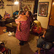 Desiree and Mindy dance their babies about the room the same day they received notice they would have to vacate the property due to landlord's loss of lease. Despite the odds that sometimes seem stacked high against them, the family stays strong.