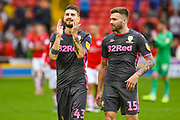 Leeds United midfielder Mateusz Klich (43) and Leeds United defender Stuart Dallas (15) react to winning 2-0 during the EFL Sky Bet Championship match between Barnsley and Leeds United at Oakwell, Barnsley, England on 15 September 2019.