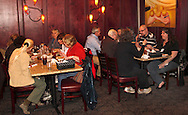 Riverside Area Chamber of Commerce hosts an International Night featuring Indian and American food at the Filling Station Sports Bar & Grill in Riverside, Monday, March 26, 2012.  Owner Doctor Suresh Gupta prepared Indian cuisine including Bean Sprout Cucumber Salad, Butter Chicken, Samosas, Rice/Naan Bread and Veggie Khorma.
