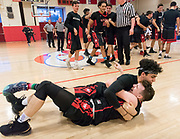 Watertown High School senior Alex Abrahamyan and captain John Korte embrace after winning the MIAA Division 3 state semifinal game against Jeremiah E. Burke High School in Burlington, March 14, 2018. The Raiders won the game, 66-61. [Wicked Local Photo/James Jesson]