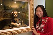 "Jeju Island. Jungmun Tourist Complex. Teddybear Museum. Toursists taking souvenir photos with ""Mona Lisa""."