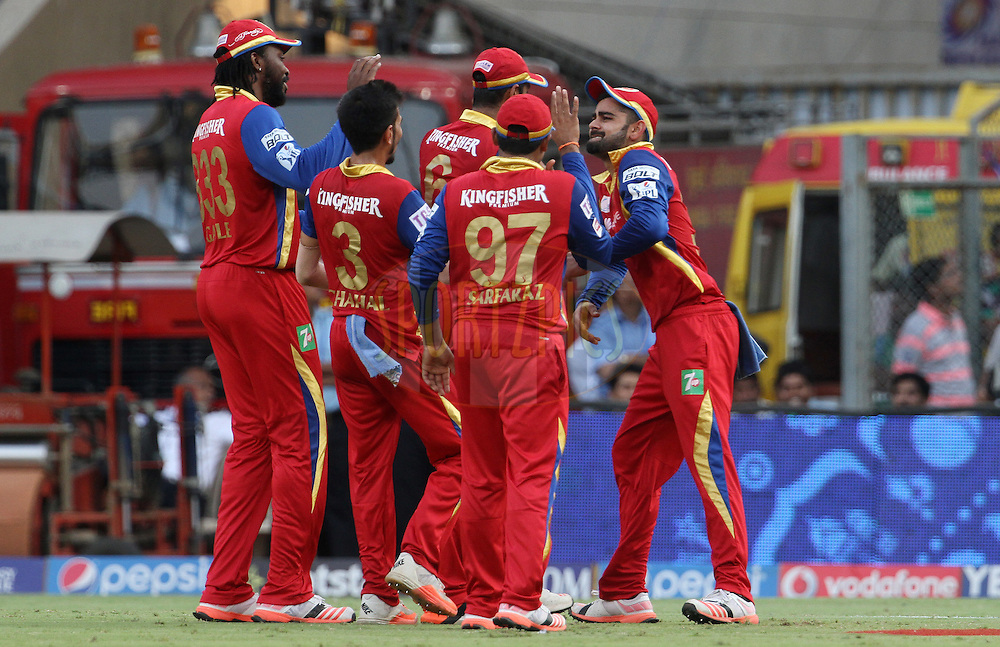 Royal Challengers Bangalore players celebrates the wicket of Mumbai Indians player Parthiv Patel during match 46 of the Pepsi IPL 2015 (Indian Premier League) between The Mumbai Indians and The Royal Challengers Bangalore held at the Wankhede Stadium in Mumbai, India on the 10th May 2015.<br /> <br /> Photo by:  Vipin Pawar / SPORTZPICS / IPL