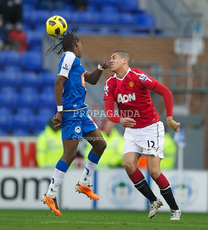 WIGAN, ENGLAND - Saturday, February 26, 2011: Manchester United's Chris Smalling and Wigan Athletic's Hugo Rodallega during the Premiership match at the DW Stadium. (Photo by David Rawcliffe/Propaganda)