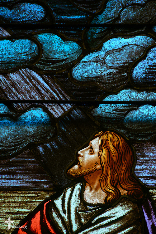 Stained glass depicting Jesus Christ praying in Gethsemane (Luke 22:42) at Zion Lutheran Church on Thursday, July 13, 2017, in Ottawa, Ill.  LCMS Communications/Erik M. Lunsford