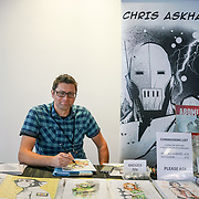 Business Design Centre, England, UK. 23rd August 2017. Chris Askham is a artist stall at the London Super Comic Convention 2017.