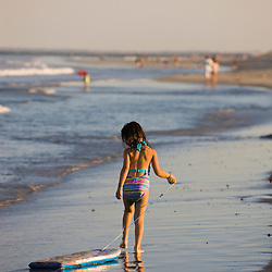 A young girl and her boogie board at Hampton Beach in Hampton Beach, New Hampshire.