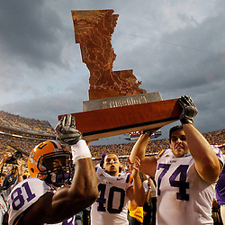 November 25, 2011; Baton Rouge, LA, USA; LSU Tigers players wide receiver Armand Williams (81), safety Rockey Duplessis (40) and guard Josh Williford (74) carry The Boot trophy following a win over the Arkansas Razorbacks at Tiger Stadium. LSU defeated Arkansas 41-17. Mandatory Credit: Derick E. Hingle-US PRESSWIRE