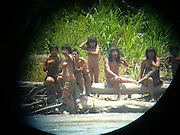 The Amazon's last lost tribe: Never-before-seen pictures capture the lives of Peruvian nomads who are untouched by civilization<br /> <br /> Never-before-seen photos have emerged of one of the last the last uncontacted Amazon tribes who the Peru government is trying to approach after they shot and killed two men in the chest with a bow and arrow.<br /> For 600 years the Mashco Piro clan – also known as Cujareno people – have lived in the forest in Peru close to the border with Brazil and had no contact with the outside world.<br /> But recently – threatened by 21st century logging, drugs cartels and tourism  – the rarely seen indigenous tribe have broken cover from the forest to raid villages for food, tools and weapons to hunt.<br /> <br /> In May, Leonardo Perez, 20, was killed when he was shot with an arrow by tribe members who wanted his tools.<br /> In 2011 local guide Shaco Flores, a Matsigenka Indian, was murdered by the tribe.<br /> Shaco had given them machetes, pots and pans for 20 years and had developed a good relationship with the clan.<br /> But it is believed he was killed with an arrow to the heart after he tried to persuade them to settle and end to their nomadic hunter-gatherer life.<br /> 'The Mashco Piro have been present in this area for as long as anyone can remember, and have in a way been enticed out of their forest home onto the riverbanks by missionaries and other missionised indigenous people,' Rebecca Spooner for campaign group International Survival told MailOnline.<br /> 'They have been given pots and land and machetes, and are now asking for more.'<br /> The increasing contact between the Mashco Piro people and other indigenous communities is slowly peeling back the layers of secrecy that have shielded them from modern society.<br /> Members of the tribe have been spotted a record 100 times already this year, Peru's deputy culture minister Patricia Balbuena said.<br /> While others have even left the forest and now live among the neighbouring Yine Indians, who speak a similar language.<br /> <br /> Campaign group