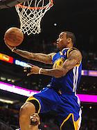 Feb. 10, 2011; Phoenix, AZ, USA; Golden State Warriors guard Monta Ellis (8) puts up a shot against the Phoenix Suns at the US Airways Center. Mandatory Credit: Jennifer Stewart-US PRESSWIRE
