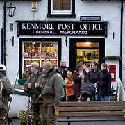 Fishermen outside the Kenmore Post Office, Perthshire, Scotland<br />