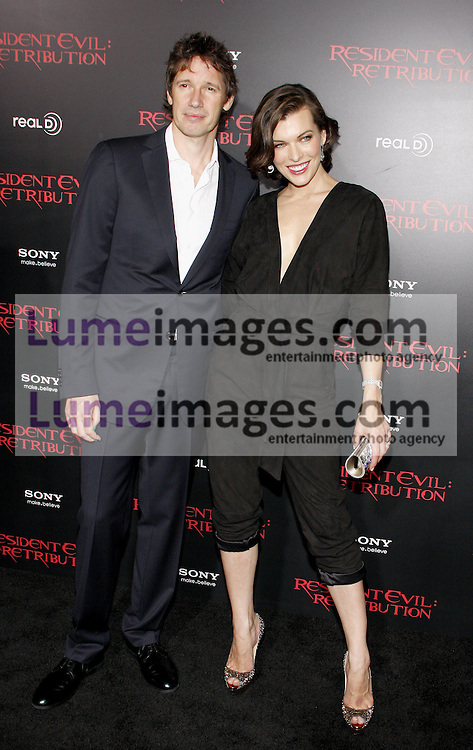 LOS ANGELES, CA - SEPTEMBER 12, 2012: Milla Jovovich and Paul W.S. Anderson at the Los Angeles premiere of 'Resident Evil: Retribution' held at the Regal Cinemas L.A. Live in Los Angeles, USA on September 12, 2012.