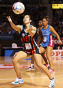 Keshia Grant gathers the ball during the ANZ Championship Netball game between the Tactix v Steel at Horncastle Arena in Christchurch. 6th April 2015 Photo: Joseph Johnson/www.photosport.co.nz