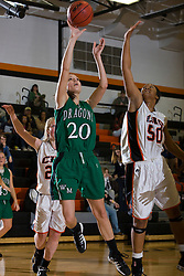 William Monroe forward Leah Krynitsky (20) shoots past Charlottesville center Shalita Brown (50).  The Charlottesville High School Lady Black Knights defeated the William Monroe High School Dragons 48-45 in girls basketball at the CHS Gymnasium in Charlottesville, VA on December 19, 2008.  (Special to the Daily Progress / Jason O. Watson)