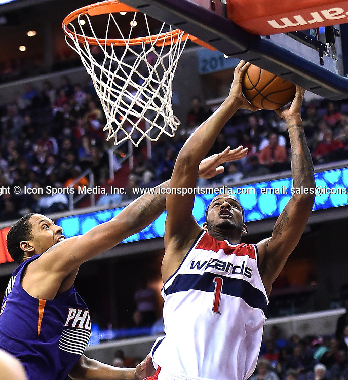 March 26, 2014 - Washington, DC, USA - Washington Wizards forward Trevor Ariza (1) is fouled by Phoenix Suns forward Channing Frye (8) during the second half of their game played at the Verizon Center in Washington, Wednesday, Mar. 26, 2014. Phoenix defeated Washington 99-93