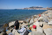 Fishermen in front of Ajaccio and its harbour.