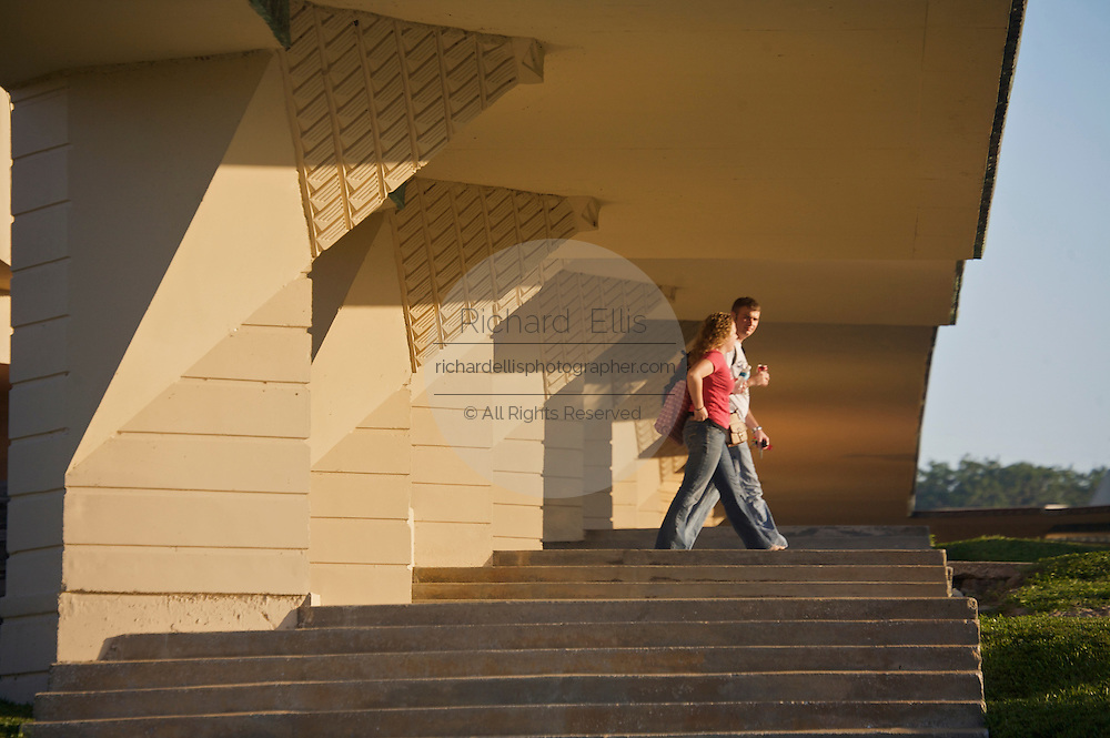 Students walk through the Esplanades designed by architect Frank Lloyd Wright on the campus of Florida Southern College in Lakeland, Florida. The building like many on campus was build with Student labor from 1939 to 1941.