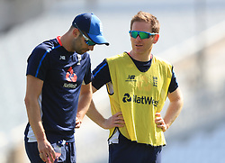 Eoin Morgan with Mark Wood during the nets session at Trent Bridge, Nottingham.