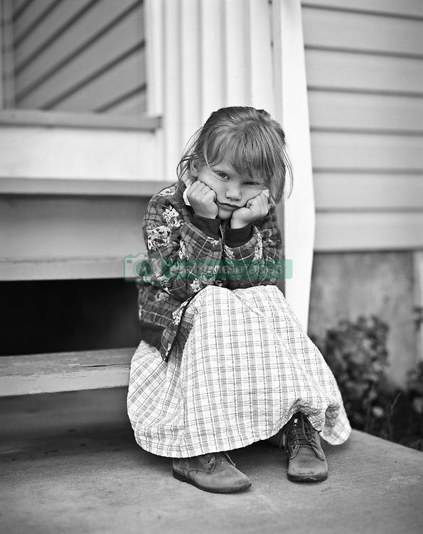 July 21, 2019 - Portrait Of Girl Sitting On Porch (Credit Image: © Ron Nickel/Design Pics via ZUMA Wire)