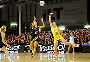 Maria Tutaia and Rebecca Bulley of the Diamonds both go for the ball..Constellation cup netball. Silver Ferns v Australian Diamonds at ILT Velodrome, Invercargill, New Zealand. Sunday 15th september 2013. New Zealand. Photo: Richard Hood/photosport.co.nz