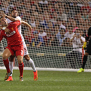 Rickie Lambert, Liverpool, is challenged by Leandro Castán, AS Roma, during the Liverpool Vs AS Roma friendly pre season football match at Fenway Park, Boston. USA. 23rd July 2014. Photo Tim Clayton
