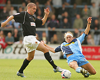 Photo: Frances Leader.<br />Wycombe Wanderers v Chester City. Coca Cola League 2.<br />01/10/2005.<br /><br />Chester's Ryan Lowe is tackled by Wycombe's Sergio Torres.