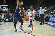 Ole Miss' Jarvis Summers (32) vs. La Salle's Tyreek Duren (3) in the Round of 32 of the NCAA Tournament at the Sprint Center in Kansas City, Mo. on Sunday, March 24, 2013. La Salle won 76-74.