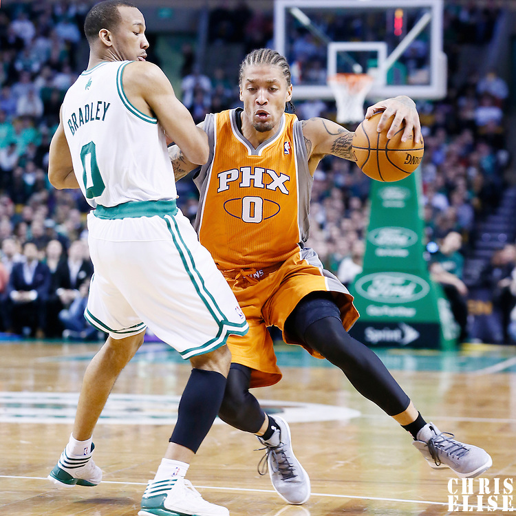 09 January 2013: Phoenix Suns small forward Michael Beasley (0) drives past Boston Celtics point guard Avery Bradley (0) during the Boston Celtics 87-79 victory over the Phoenix Suns at the TD Garden, Boston, Massachusetts, USA.
