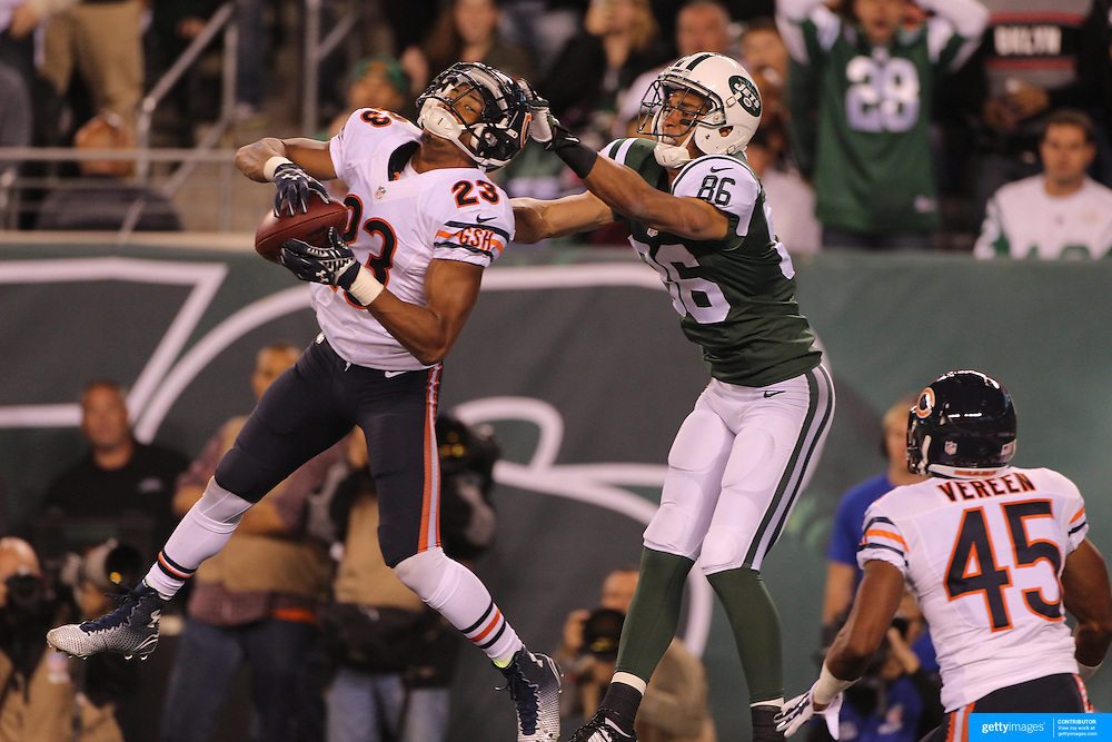 Kyle Fuller, Chicago Bears, intercepts a Geno Smith pass in the end zone intended for David Nelson, (right), New York Jets,  during the New York Jets Vs Chicago Bears, NFL regular season game at MetLife Stadium, East Rutherford, NJ, USA. 22nd September 2014. Photo Tim Clayton for the New York Times