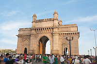 People at Gateway of India, Mumbai's tourist district and most famous landmark