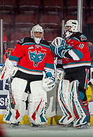 KELOWNA, CANADA - NOVEMBER 21:  James Porter #1 and Roman Basran #30 of the Kelowna Rockets speak on the ice during warm up against the Regina Pats on November 21, 2018 at Prospera Place in Kelowna, British Columbia, Canada.  (Photo by Marissa Baecker/Shoot the Breeze)