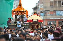 September 15, 2016 - Kathmandu, NE, Nepal - Devotees carrying God 'Ganesh' for the chariot pulling festival on the third day of Indra Jatra Festival celebrated at Basantapur Durbar Square, Kathmandu, Nepal on Thursday, September 15, 2016. Devotees celebrated the god of rain 'Indra' for 8 days in Kathmandu. (Credit Image: © Narayan Maharjan/NurPhoto via ZUMA Press)