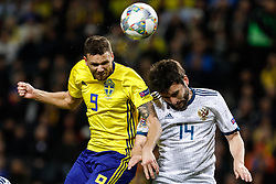 November 20, 2018 - Stockholm, Sweden - Marcus Berg (L) of Sweden and Georgi Dzhikiya of Russia vie for a header during the UEFA Nations League B Group 2 match between Sweden and Russia on November 20, 2018 at Friends Arena in Stockholm, Sweden. (Credit Image: © Mike Kireev/NurPhoto via ZUMA Press)